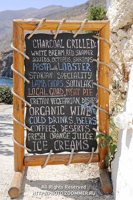 Traditional menu black-board in tavern in Chora Sfakion, Crete, Greece