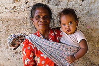 Rosa, 64, with one of her grandchildren, Estado village, Ermera district, Timor Leste, 04/09/12. Rosa is a widower with 6 children and 20 grandchildren.