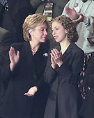 First lady Hillary Rodham Clinton and daughter Chelsea Clinton share a thought as they applaud during the State of the Union Address delivered by United States President Bill Clinton in the U.S. House Chamber of the U.S. Capitol in Washington, D.C. on January 27, 2000.<br /> Credit: Ron Sachs / CNP