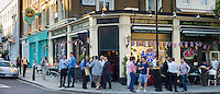 Customers enjoying warm weather at The Duke of York traditional London pub in St John's Wood, London