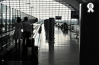 Couple at Airport (Licence this image exclusively with Getty: http://www.gettyimages.com/detail/83154160 )