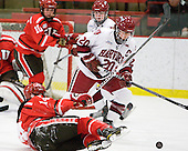 Vanessa Emond (St. Lawrence - 14), Kate Buesser (Harvard - 20) - The Harvard University Crimson defeated the St. Lawrence University Saints 8-3 (EN) to win their ECAC Quarterfinals on Saturday, February 26, 2011, at Bright Hockey Center in Cambridge, Massachusetts.