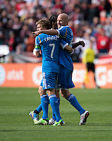 Conor Casey (6) of the Philadelphia Union celebrates his goal with teammate Brian Carroll (7)  during the game at the RFK Stadium in Washington DC.  Philadelphia defeated D.C. United, 3-2.