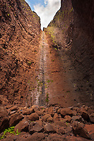 The now dry waterfall at the back of remote Miloli'i Canyon on the rugged Na Pali coast of Kauai