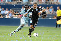 San Jose defender Ramiro Corrales (12) ges past Kei Kamara Kansas City... Sporting Kansas City defetaed San Jose Earthquakes 2-1 at LIVESTRONG Sporting Park, Kansas City, Kansas.