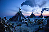 "A colony of tents, or ""chums"", belonging to Nenets herders stand in the Arctic tundra in the Russian Nenets Autonomous Region. The are the original people living in the Russian Arctic, before being crushed by Soviet collectivisation and affected by modern oil and gas exploration."