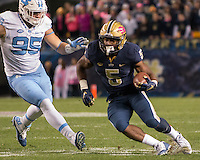 Pitt running back Chris James is pursued by North Carolina defensive tackle Tyler Powell (95). The North Carolina Tar Heels football team defeated the Pitt Panthers 26-19 on Thursday, October 29, 2015 at Heinz Field, Pittsburgh, Pennsylvania.