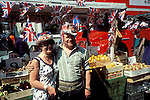 Silver Jubilee celebrations, London 1977.Uk  Street market vendor posing with  a tourist.