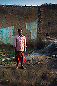40 year old Bisheswar Guhiya (Mantu) poses for a portrait next to his house in Bokapahari village in Jharia, outside of Dhanbad in Jharkhand, India.  Photo: Sanjit Das/Panos