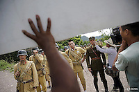 """A crew member applies make-up to an actor's face during filming of """"The Last Prince"""" television series on location near Hengdian World Studios near Hengdian July 24, 2015. There are eleven productions about the war against Japan being filmed at Hengdian World Studios. The facility itself, located in China's Zheijang province, is the biggest movie lot ever built. Director Li Xiaoqiang said the series is about a Qing Dynasty prince, who joined the Chinese nationalist army after suffering family misfortune. """"After he learnt more about the Communist Party, the prince began to understand what real revolution and the anti-Japanese war meant, and turned to the Communist Party to fight Japan"""", the director added. According to local media, more than 10 new movies, 12 TV dramas, 20 documentaries and 183 war-themed stage performances will be released in China to coincide with the 70th anniversary of the end of World War Two. REUTERS/Damir SagoljPICTURE 4 OF 28 FOR WIDER IMAGE STORY """"BEHIND THE SCENES OF A CHINESE WAR DRAMA"""".SEARCH """"SAGOLJ STUDIO"""" FOR ALL PICTURES."""