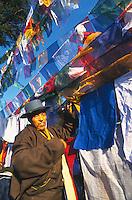 Tibetans tying prayer flags druing Losar, Tibetan New Year.