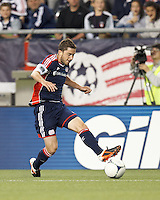 New England Revolution defender Chris Tierney (8) passes the ball. In a Major League Soccer (MLS) match, the New England Revolution defeated Vancouver Whitecaps FC, 4-1, at Gillette Stadium on May 12, 2012.