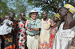 Father Richard O'Dwyer, a Jesuit from Ireland, talks with women at the Multi Agricultural Jesuit Institute of Sudan (MAJIS), an agricultural school located outside Rumbek, South Sudan. O'Dwyer is the school's director.