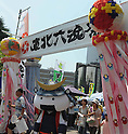 July 16th, 2011, Sendai, Japan - Musubimaru, mascot of Sendai city,passes through a gate of the Tohoku Rokkon Festival, July 16, 2011, in Sendai city, Miyagi prefecture, northeastern Japan, about 90km away from the tsunami-crippled Fukushima Daiichi Nuclear Power Plant. The six major festivals in the Tohoku region, comprising Sansa Odori in Iwate, Nebuta Matsuri in Aomori, Tanabata Matsuri in Sendai, Hanagasa Matsuri in Yamagata, Kanto Matsuri in Akita, and Waraji Matsuri in Fukushima, are performed together at Tohoku Rokkon Festival for the first time to overcome the many harmful rumors and atmosphere of excessive restraint, to recover the visiting population in order to revive the regional economy, and accomplish reconstruction after the March 11's earthquake and tsunami. (Photo by Tomoyuki Kaya/AFLO) [3694]