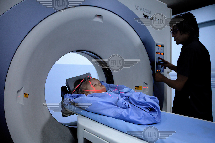 Victoria has a CT scan at Annapurna Neurological Institute in Kathmandu. 19 month old Victoria (formerly named Ghane) was born with hydrocephalus and was left abandoned. Cecilie Hansen was so moved by the story of Ghane she read in a Danish newspaper that she decided to fly to Kathmandu to try to assist her and show her the love of another human being; Cecilie eventually became her legal guardian. Victoria died on November 19 2010 from heart failure.