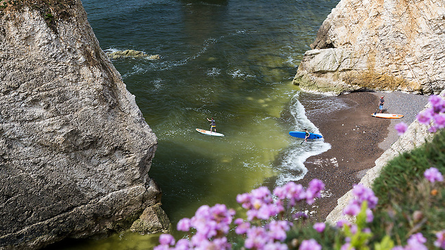 Stand up Paddleboard riders at Freshwater Bay on the Isle of Wight