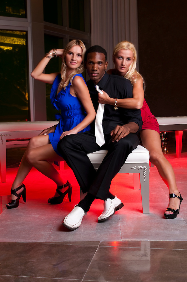 Young caucasian womans seated in a lounge with an African American man.