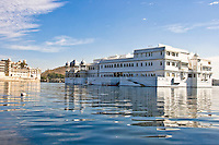 The famous Taj Lake Palace built with white marble, floating in the middle of Lake Pichola - a blend of serenity and opulence. (Photo by Matt Considine - Images of Asia Collection)