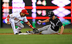 16 August 2008: Colorado Rockies' left fielder Matt Holliday steals second base avoiding the tag by Washington Nationals infielder Emilio Bonifacio in the fifth inning at Nationals Park in Washington, DC.  The Rockies defeated the Nationals 13-6, handing the last place Nationals their 9th consecutive loss. ..Mandatory Photo Credit: Ed Wolfstein Photo
