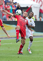 29 June 2013: Toronto FC forward Danny Koevermans #14 and Real Salt Lake defender Aaron Maund #4 in action during an MLS game between Real Salt Lake and Toronto FC at BMO Field in Toronto, Ontario Canada.<br /> Real Salt Lake won 1-0.