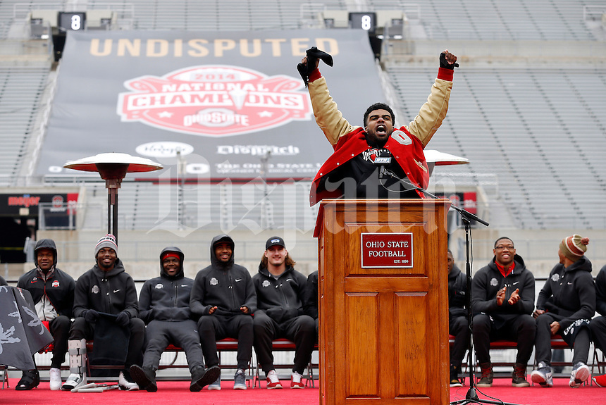 Ohio State Buckeyes running back Ezekiel Elliott reacts to seeing himself on the big screen during the celebration for winning the national championship at Ohio Stadium on Jan. 24, 2015. (Adam Cairns / The Columbus Dispatch)