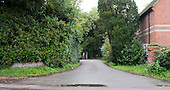Main entrance of the street, Summerhill School, Leiston, Suffolk. The school was founded by A.S.Neill in 1921 and is run on democratic lines with each person, adult or child, having an equal say.  You don't have to go to lessons if you don't want to but could play all day.  It gets above average GCSE exam results.