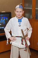 Young Caucasian Warrior Boy with Sword in Costume