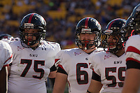 Gardner-Webb tackle David McConnell (75), guard Jamie Dunaway (middle) and center Austin Sargent (59) huddle up. The Pitt Panthers defeated the Gardner-Webb Runnin Bulldogs 55-10 at Heinz Field, Pittsburgh PA on September 22, 2012..