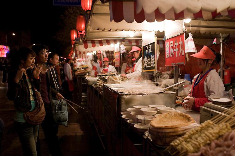 Stall selling meat kebabs and soup dumplings in the Night Market, Wangfujing Street, Beijing, China