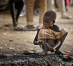 A displaced boy plays in the mud in Agok, a town in the contested Abyei region where tens of thousands of people fled in 2011 after an attack by soldiers and militias from the northern Republic of Sudan on most parts of Abyei. Although the 2005 Comprehensive Peace Agreement called for residents of Abyei--which sits on the border between Sudan and South Sudan--to hold a referendum on whether they wanted to align with the north or the newly independent South Sudan, the government in Khartoum and northern-backed Misseriya nomads, excluded from voting as they only live part of the year in Abyei, blocked the vote and attacked the majority Dinka Ngok population. The African Union has proposed a new peace plan, including a referendum to be held in October 2013, but it has been rejected by the Misseriya and Khartoum.