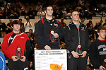 12 MAR 2011:  Aaron Denson of Nebraska-Omaha (in black) on the podium with his award after defeating Charlie Pipher of Western State during the Division II Men's Wrestling Championship held at the UNK Health and Sports Center on the University of Nebraska - Kearney campus in Kearney, NE.  Denson defeated Pipher 6-4 to win the 184-lb national title. Scott Anderson/NCAA Photos