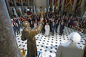 Pope Francis (Front C) pauses in front of a sculpture of Spanish-born Junipero Serra, the Franciscan Friar known for starting missions in California, in Statuary Hall at the U.S. Capitol in Washington DC, USA, 24 September 2015. Pope Francis is on a five-day trip to the USA, which includes stops in Washington DC, New York and Philadelphia, after a three-day stay in Cuba. Pope Francis added the Cuba visit after helping broker a historic rapprochement between Washington and Havana that ended a diplomatic freeze of more than 50 years.<br /> Credit: Michael Reynolds / Pool via CNP