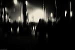 People silhouettes of a crowd moving in the darkness in the streets of Amsterdam and celebrate New Year's Eve.