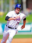 2 March 2010: New York Mets' first baseman Ike Davis hustles to third against the Atlanta Braves during the Opening Day of Grapefruit League play at Tradition Field in Port St. Lucie, Florida. The Mets defeated the Braves 4-2 in Spring Training action. Mandatory Credit: Ed Wolfstein Photo