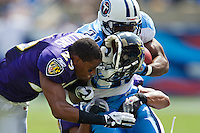 NASHVILLE, TN - SEPTEMBER 18:   Cary  Williams #29 of the Baltimore Ravens loses his helmet while making a hit on Javon Ringer #21 of the Tennessee Titans at the LP Field on September 18, 2011 in Nashville, Tennessee.  (Photo by Wesley Hitt/Getty Images) *** Local Caption *** Cary Williams; Javon Ringer