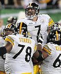 Pittsburgh Steelers quarterback Ben Roethlisberger (7) looks at the scoreboard as he leaps into his teammates' arms after throwing the winning touchdown with second to go to defeat the Arizona Cardinals 27-23 in the 43rd Super Bowl in Tampa, Florida February 1, 2009.