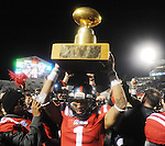 Mississippi' Randall Mackey (1) holds aloft the Golden Egg following the game against Mississippi State at Vaught Hemingway Stadium in Oxford, Miss. on Saturday, November 24, 2012. Mississippi won 41-24. (AP Photo/Oxford Eagle, Bruce Newman).