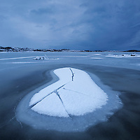 Snow and ice formations on frozen Vatnfjord in winter, Austvågøy, Lofoten Islands, Norway