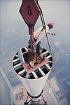Installing the antenna to the top of the North Tower, May 1979...1979 © Peter B. KAPLAN / CONTACT Press Images