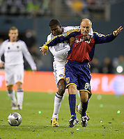 Edson Buddle, left,  holds onto Clint Mathis, right, during the first half of play. Real Salt Lake defeated the Los Angles Galaxy on penalty kicks to win the 2009 MLS Cup at Qwest Field, Sunday, Nov. 22, 2009.