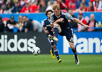 22 May 2010: New England Revolution defender Pat Phelan #28 in action during a game between the New England Revolution and Toronto FC at BMO Field in Toronto..Toronto FC won 1-0.....