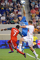 New York Red Bulls goalkeeper Greg Sutton (24) punches a ball clear. The New York Red Bulls defeated Toronto FC 5-0 during a Major League Soccer (MLS) match at Red Bull Arena in Harrison, NJ, on July 06, 2011.