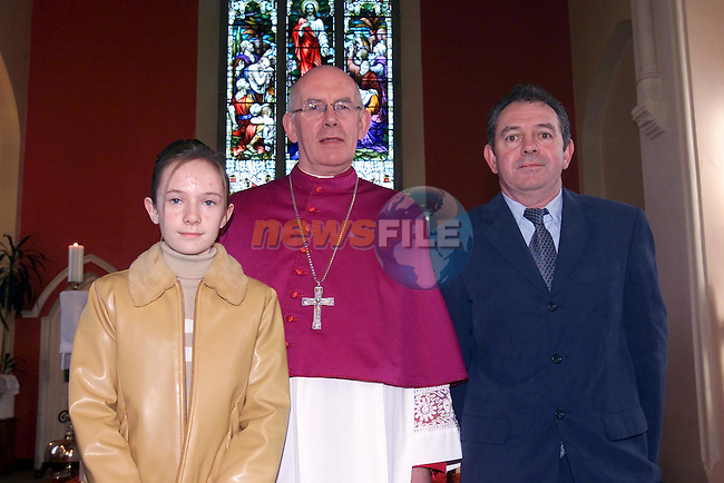 Sinead and Joe O'Neill and Bishop Brady after confirmation in Clogherhead Church..Picture Fran Caffrey Newsfile.