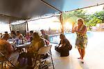 Friday nights at the Hotel Molokai hosts Na Kupuna where people gather casually to play music and dance hula on the island of Molokai, Hawaii, USA