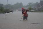 Chris Conley attempts to clear a drain as a flash flood occurs in Notting Hill in Oxford, Miss. on Wednesday, April 27, 2011.