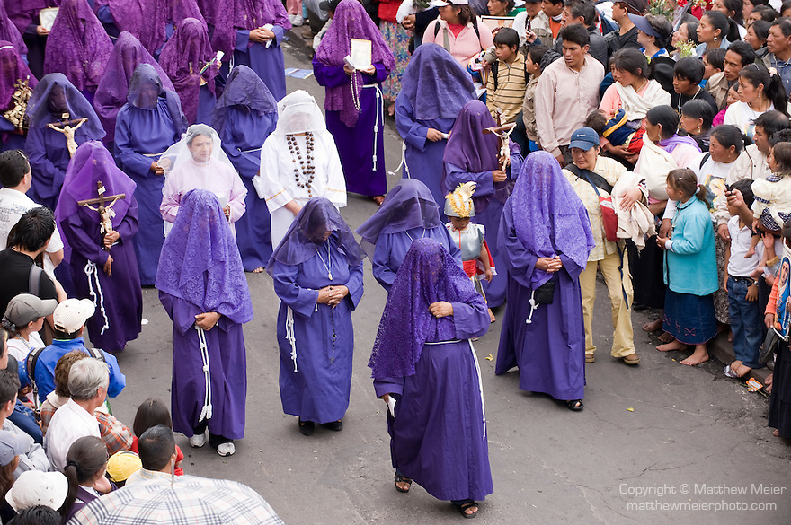Plaza San Francisco, Centro Historico, Quito, Ecuador; the great procession on Good Friday, the last Friday of Holy Week, tens of thousands of people march through El Centro, many wearing traditional purple-hooded cucuruchos, representing penitents, and women wearing robed Veronicas, wearing purple dresses and black shrouds, as well as worshippers dressed as Jesus Christ carrying crosses, some donning thorny headpieces and chains around their feet, beginning at noon, the procession ends at 3 pm, the hour of Jesus' death, viewed from the 2nd story balcony of El Cafe de San Francisco on the corner of Simon Bolivar and Sebastian de Benalcazar , Copyright © Matthew Meier, matthewmeierphoto.com All Rights Reserved