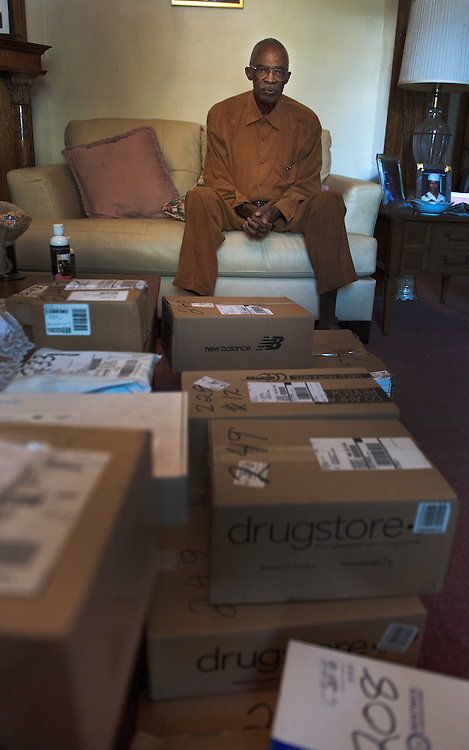 UNITED STATES - August 30: 30: William Outlaw poses with some of the days packages he has collected for his neighbors. Mr. Outlaw age 84 takes in packages for an entire block so they will not get stolen off the front porch, in an effort to bring community closer together. (Photo By Douglas Graham/Roll Call)