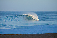 Haleiwa Hawaii, (Wednesday November 16, 2010) .An empty wave rolls into Off The Wall as the first rays of sun come over the mountians..Photo: joliphotos.com