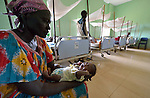 Raush Deng holds her 21-day old baby James in the St. Daniel Comboni Catholic Hospital in Wau, South Sudan.