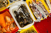 Wide variety of seafood, including fresh lobsters, uncooked fish roe sacs and squids, is seen at Chorrillos seafood and fish market in Lima, Peru, 31 March 2013.